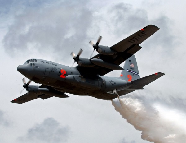 A C-130H Hercules from the 302nd Airlift Wing, Peterson Air Force Base, Colo., drops water May 2, 2007, at the Albuquerque (N.M.) Air Tanker Base during annual Modular Airborne Fire Fighting System training. C-130 aircrews from the Air Force Reserve Command unit and three Air National Guard units trained with  MAFFS delivery system in preparation for the 2007 wild fire season.  (U.S. Air Force photo/Tech. Sgt. Rick Sforza)